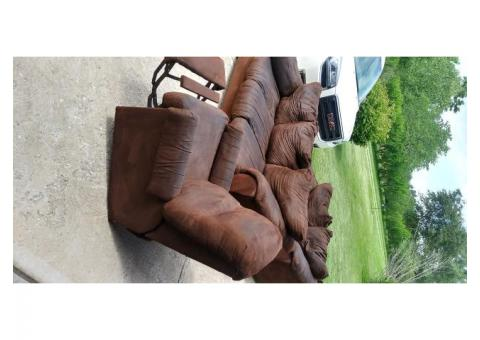 Brown sofa, love seat and recliner